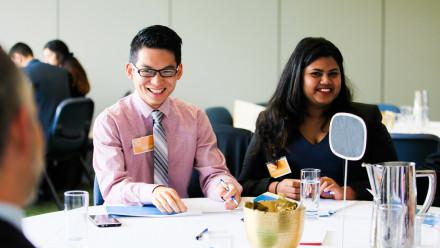 Two students sitting at a table at an employer event
